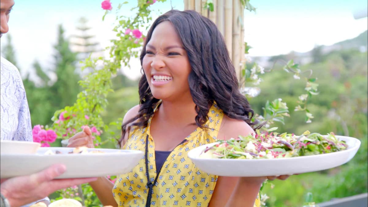 Siba heats up the braai, or grill, for a competition against Pastor Phil.